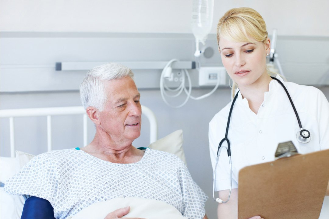 Male patient with blonde nurse holding clipboard